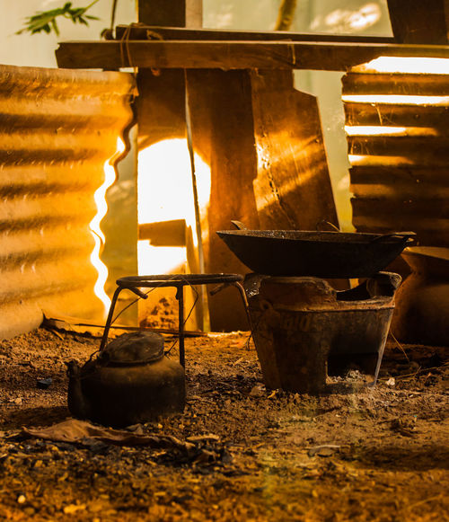 Kitchen appliances outside the home of rural life. Ashes Charcoal Close-up Food Freshness Hot Pot Indoors  Kitchen Light And Shadow Night No People Old Outside Pan Pot Pot Stand Rural Lifestyle Stain Stove