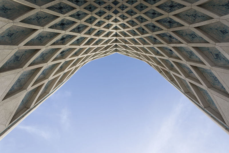 TEHRAN, IRAN - 7 May 2018 Detail of Azadi Tower gate formerly known as the Shahyad Tower is a monument located at Azadi square and is a landmark of Tehran Ancient Civilization Arch Archaeology Architectural Column Architecture Azadi Tower In Tehran Bridge Building Exterior Built Structure City Day Directly Below Entrance Detail History Low Angle View Memorial Monument No People Outdoors Pattern Sky The Past Tourism Travel Travel Destinations