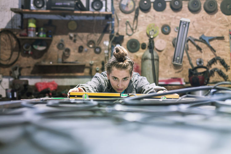 Woman Working At Workshop