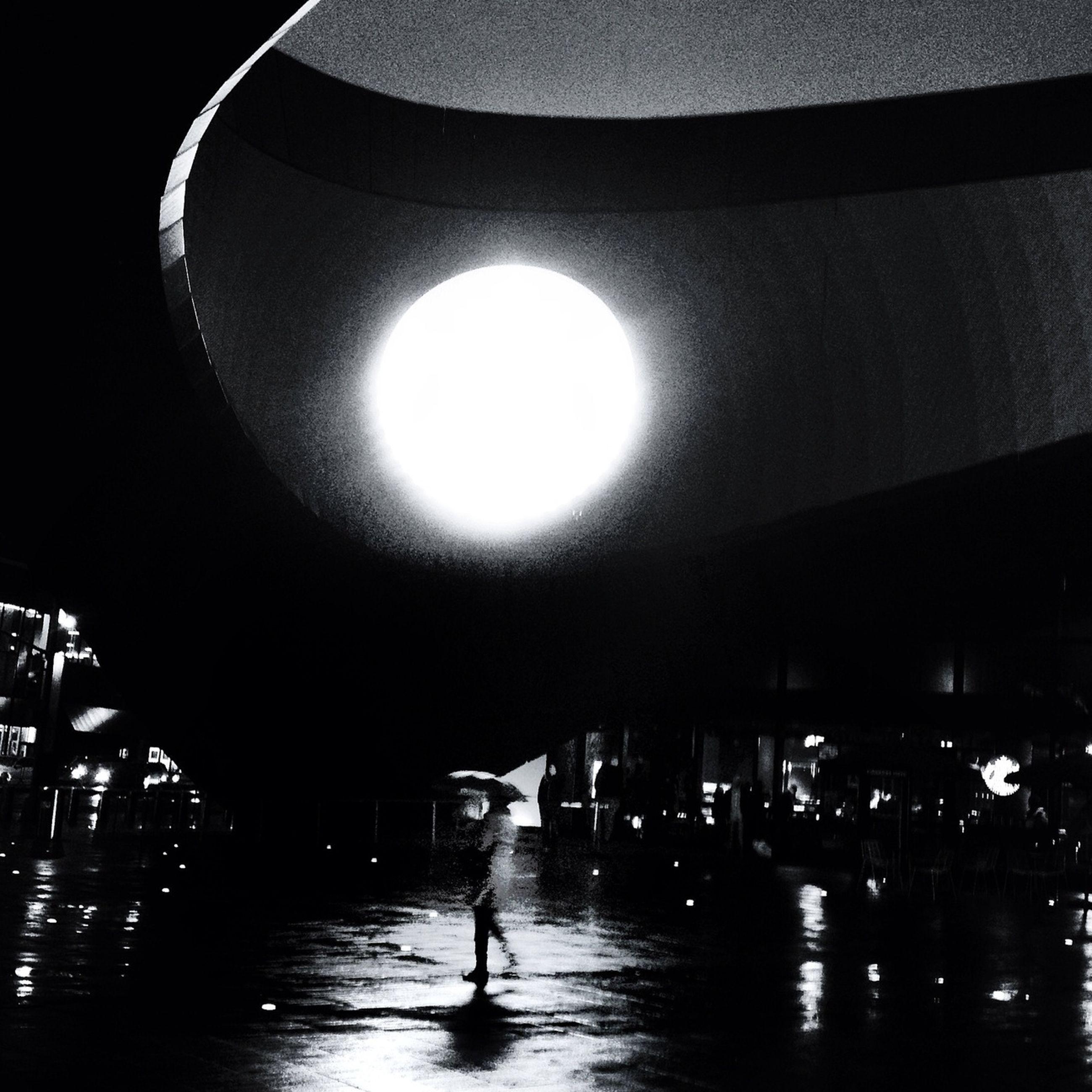 illuminated, lighting equipment, night, indoors, lifestyles, built structure, architecture, men, walking, reflection, leisure activity, city life, transportation, full length, city, person, street light, electric light