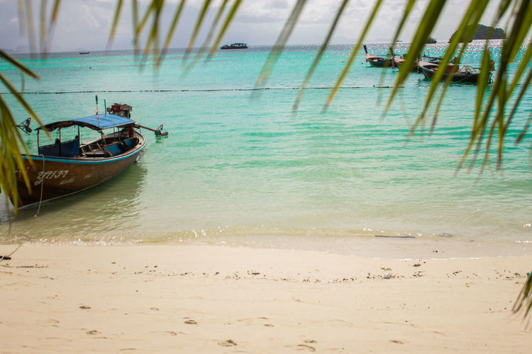 Sky & Sea Beach Beauty In Nature Day Holiday Land Mode Of Transportation Moored Nature Nautical Vessel No People Outdoors Rowboat Sand Scenics - Nature Sea Tranquil Scene Tranquility Transportation Travel Turquoise Colored Water