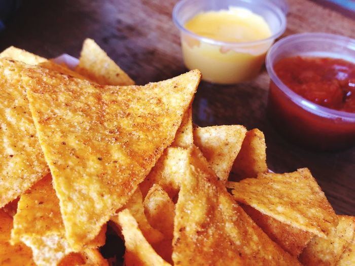Close-up of tortilla chips served on table