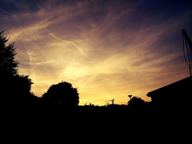 Sunset silhouette August Evening Sunset Silhouettes Evening Rich Vapour Trails Calm Trainline Peaceful