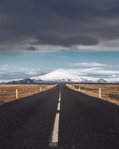 Took a 1,500 mile road trip around Iceland. I have to say it is the most photogenic place i have been too. Iceland Cloud - Sky Diminishing Perspective Direction Dividing Line Environment Iceland_collection Icelandic Marking Mountain Mountain Range Nature No People Road Road Marking Scenics - Nature Sign Sky Snow Snowcapped Mountain Symbol The Way Forward Tranquil Scene Transportation Winter