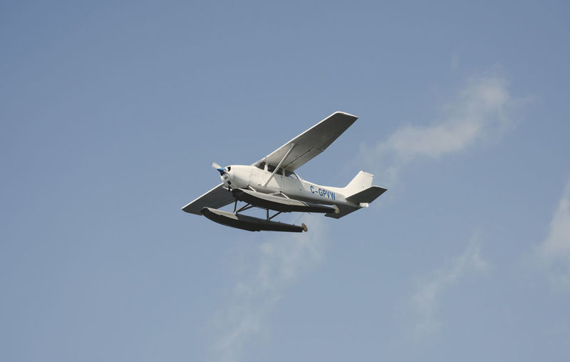Copy Space Plane Travel Travel Photography Airplane Blue Clouds Day Destination Flight Floatplane Flying Minimalism Outdoors Sky Small Plane Travel Destinations White