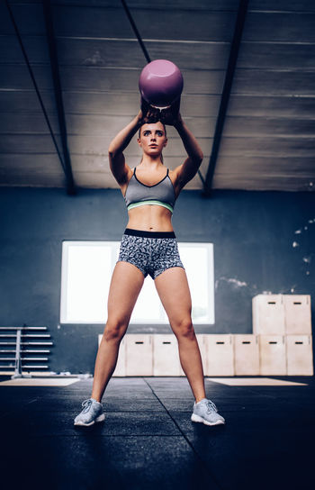 Woman Exercising With Kettlebell