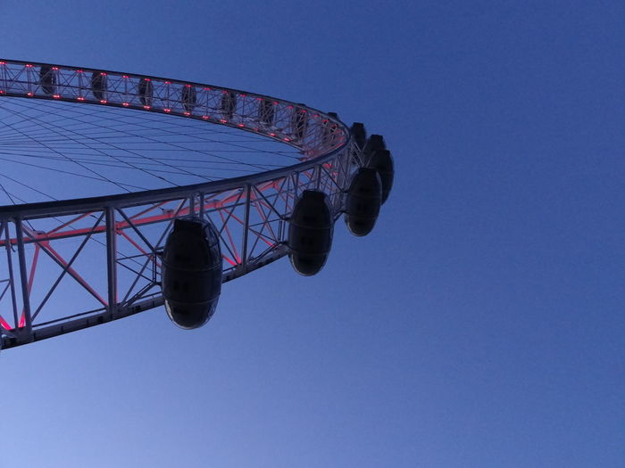 Low Angle View Of London Eye Against Clear Blue Sky
