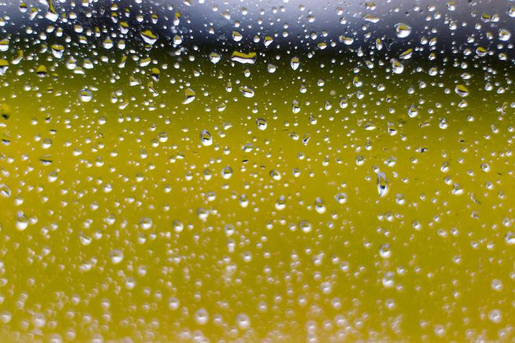 Full frame shot of water drops on glass