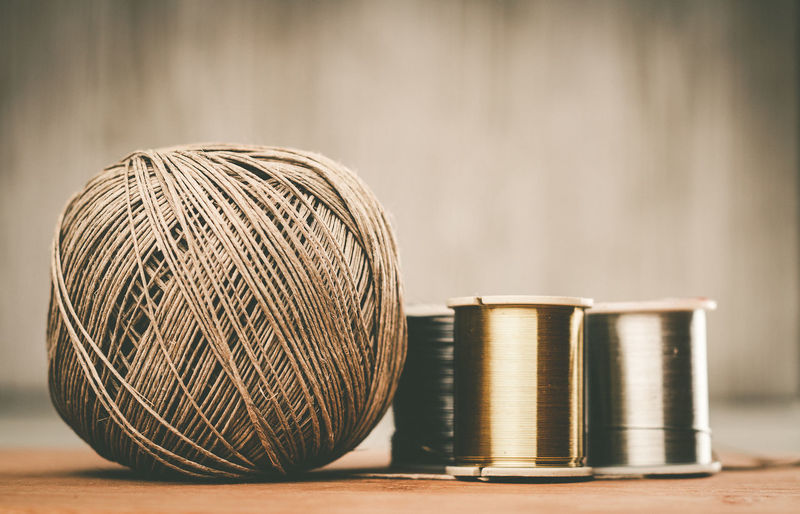 Close-up of thread spools on table