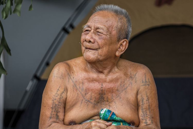 Portrait of shirtless man standing outdoors