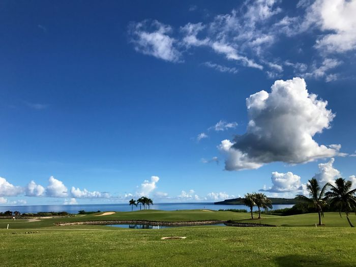 Sky Cloud - Sky Nature Beauty In Nature Scenics Tranquility Day Tranquil Scene Grass Landscape Outdoors Blue Field Saipan Golf Tree Golf Course Growth Sea Water
