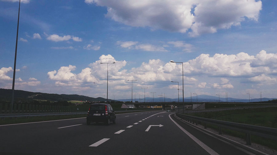 Autostrada Car Road Highway Transportation The Way Forward Travel Journey Cloud - Sky Road Trip Sky Day Travel Destinations Car Point Of View No People Outdoors Road Sign City Landscape Poland 💗 Poland Is Beautiful Week Of Eyeem Week Of Poland EeyemBestEdits Atmospheric Perspective Focus On Foreground