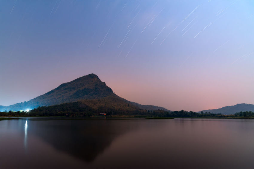 Astronomy Beauty In Nature Clear Sky Galaxy Lake Moon Mountain Mountain Range Nature Night No People Outdoors Scenics Sky Star - Space Star Trail Tranquil Scene Tranquility Water
