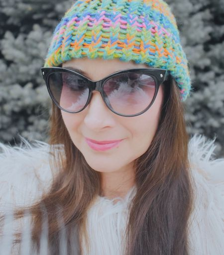 Close-up portrait of young woman wearing sunglasses during winter