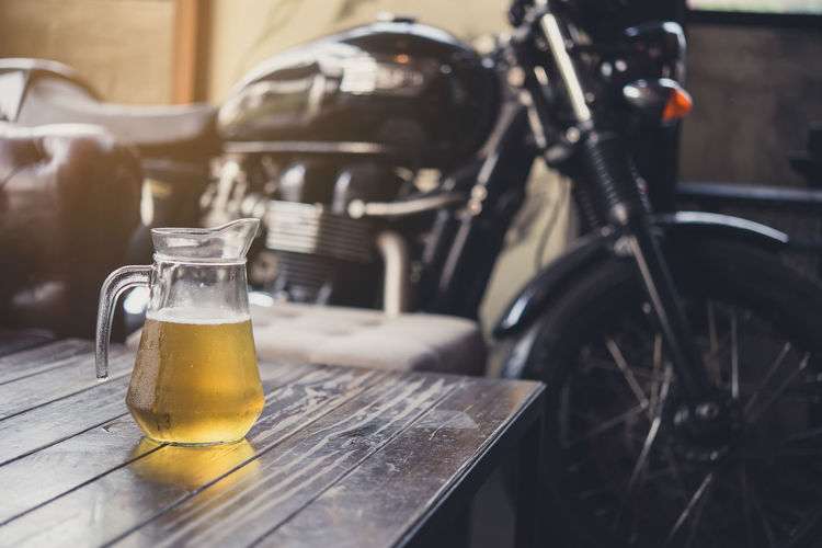 Beer Pitcher By Motorcycle On Table
