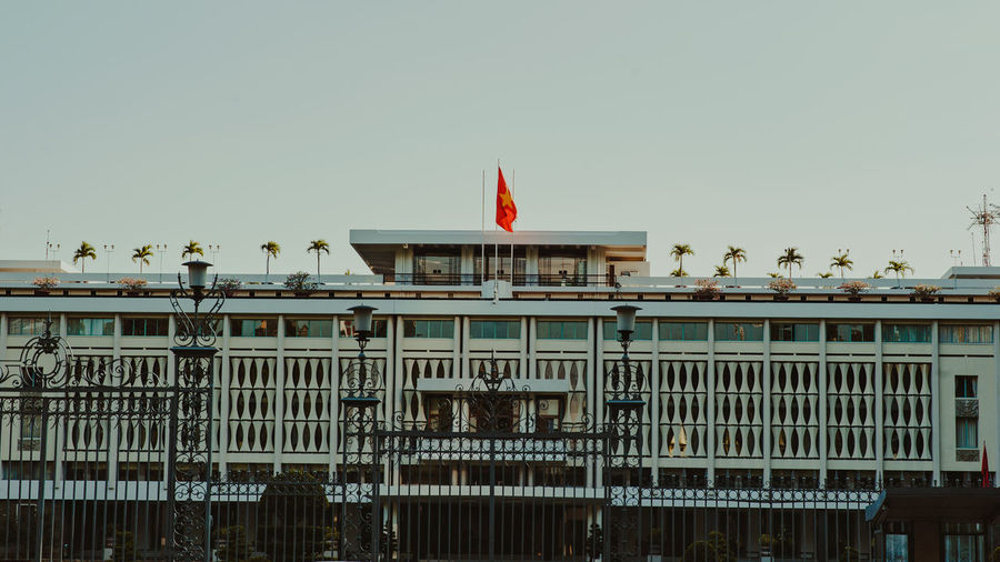 In some corners of Sai Gon DinhĐộcLập Sai Gon City Architecture Building Exterior Built Structure City Clear Sky Day Flag No People Outdoors Patriotism Sky