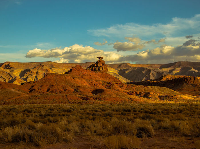 Mexican Hat Beauty In Nature Cloud - Sky Day Desert Landscape Mexican Hat Mountain Mountain Range Nature No People Outdoors Physical Geography Scenics Sky Travel Destinations
