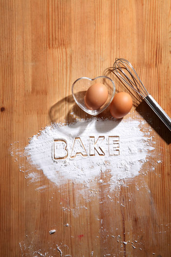 baking concept,hand whisk and eggs Food Food And Drink Egg Eggs Preparation  Flour Baking Bakery Homemade Ingredient Cooking Powder Pastry Healthy Eating Wood - Material Concept Recipe Hand Whisk Whisk Alphabet Heart Shape Glass - Material Container Bake Western Script