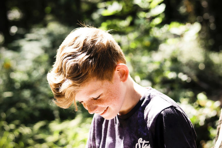 Portrait of boy in the woods. Children Trees Wood Young Youth Boy Boys Child Childhood Day Forest Hair Headshot Human Face Lifestyles Nature One Person Outdoors Portrait Portraiture Real People Sunlight Tree Woods Young Adult