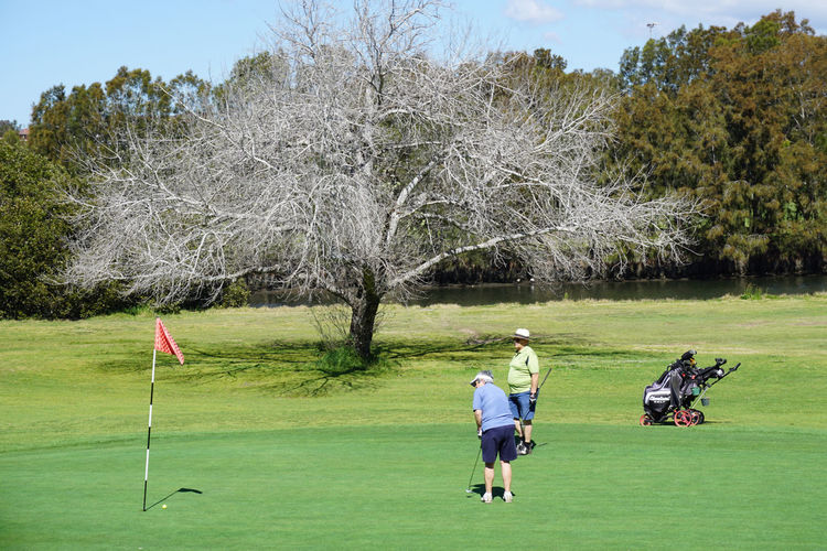 Friends playing with golf course