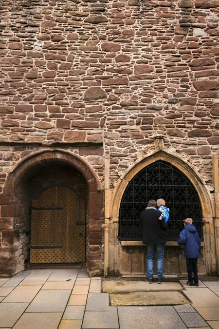 Two People Scotland Home Interior Ancient Civilization Scottish Highland Family HistoryArch Full Length Architecture Brick Wall Adults Only Built Structure Building Exterior Outdoors Entrance Place Of Worship People Adult Togetherness Men Fort Day Only Men