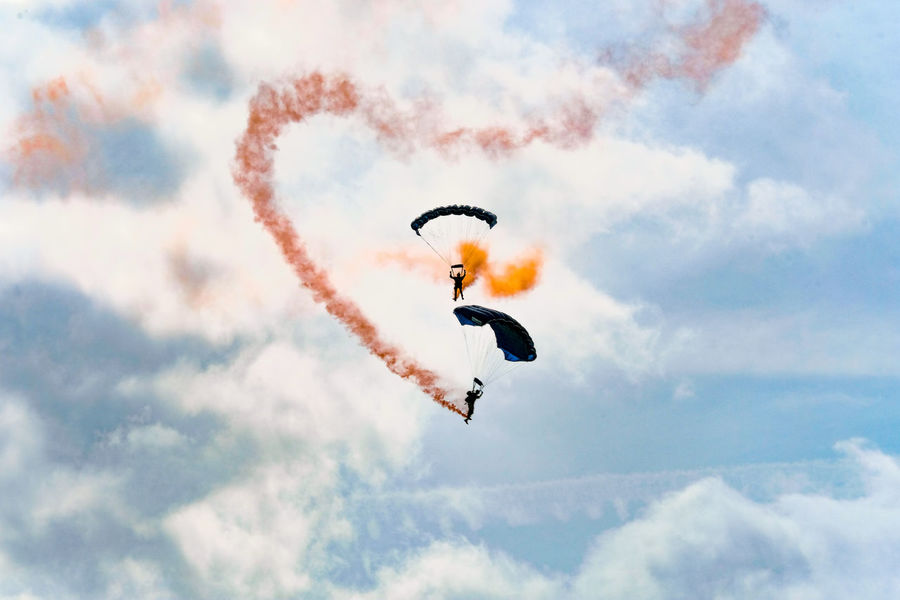The Tigers Parachute Display Team in action at the Clacton-on-Sea Airshow 2017. Clacton-on-Sea Essex Essex Sunshine Coast Smoke Tigers Parachute Display Team Aerobatics Airshow Cloud - Sky Clouds Day Low Angle View Mid-air Nature No People Outdoors Parachute Parachutist Sky Teamwork Two