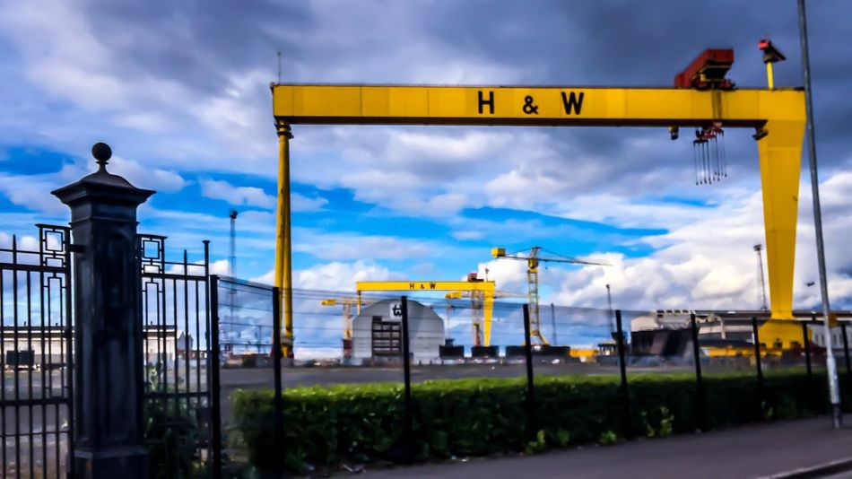 Roadside Harland And Wolff Harland&Wolff Shipyard Gates Titanic Belfast Samson And Goliath Cranes Sculpture EyeEm Selects Cloud - Sky Sky Architecture Nature Building Exterior Built Structure No People Day Outdoors Blue Beauty In Nature Street Light Lighting Equipment Yellow Railing Plant Dusk Street Sign