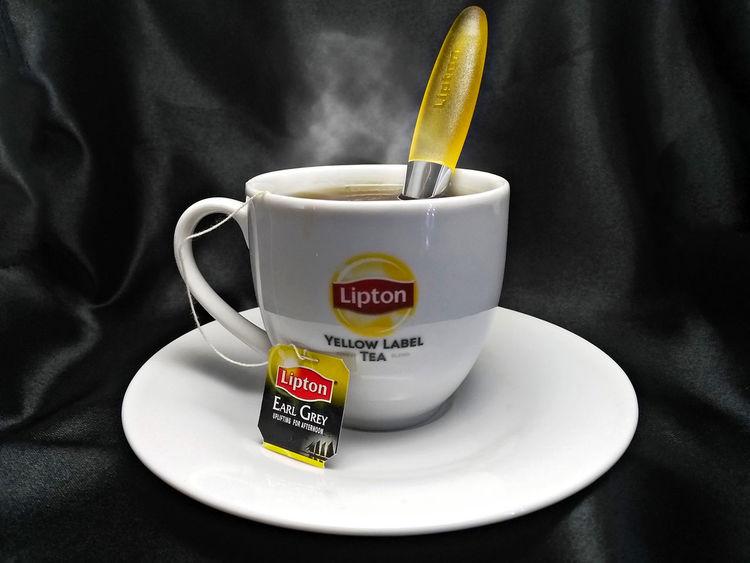 Hot Lipton Tea EarlGrey EyeEmNewHere EyeEmNewHere. Hot Spoon Steam Tea Close-up Coffee - Drink Day Delicious Drink Drinking Food Food And Drink Freshness Good Hottie Indoors  Lipton No People Table Tea - Hot Drink Tea Time Text
