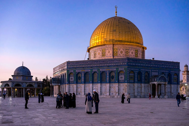 People at masjidil aqsa mosque against clear sky