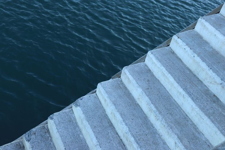 High angle view of staircase by sea