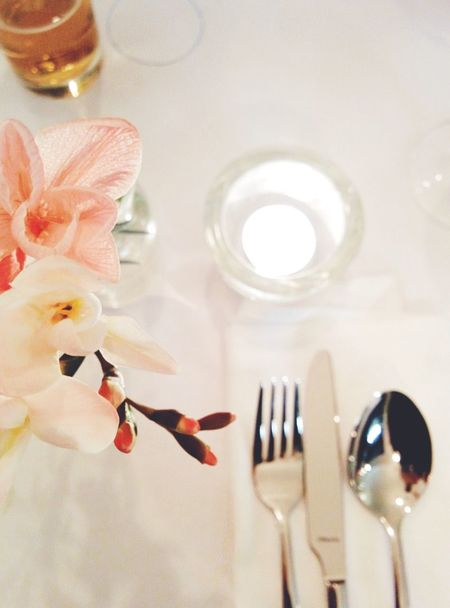 Indoors  Holding Part Of Food And Drink Freshness Wineglass Person Flower Reflection Restaurant Cuttlery White Flowers Focus On Foreground Decoration Large Group Of Objects Personal Perspective Domestic Life