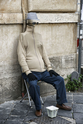 Moving Around Rome Street Artist Adult Adults Only Beggar Building Exterior Chair Day Full Length No Face One Man Only One Person Only Men Outdoors People Sitting Without Head Visual Creativity The Street Photographer - 2018 EyeEm Awards