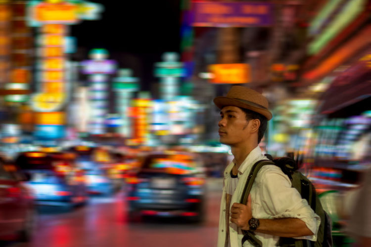 One Person City Waist Up Architecture Occupation Transportation Illuminated Night Clothing Looking City Life Young Adult Men Blurred Motion Working Standing Motion Hat Street Outdoors Thaialand Bangkok Chinatown Tourism Tourist