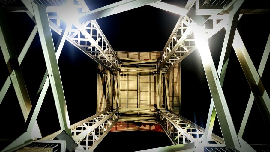 Looking up at something new Architecture No People Abstract Cellphone Photography Outdoors Structure High View Urban Under Metal Night Lights Standing Under Perspective Viewpoint