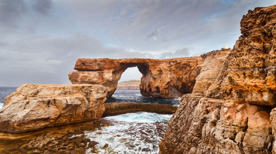 The Azure Window AzureWindow Area Gozo Dwejra Window Game Of Thrones Malta The Azure Window Arch Azurewindow Beauty In Nature Cloud - Sky Game Of Thrones Location It-Tieqa Żerqa Limestone Arch Maltaphotography Natural Arch Natural Wonder No People Non-urban Scene Outdoors Rock Rock - Object Rock Formation Scenics - Nature Sea Tranquil Scene Water