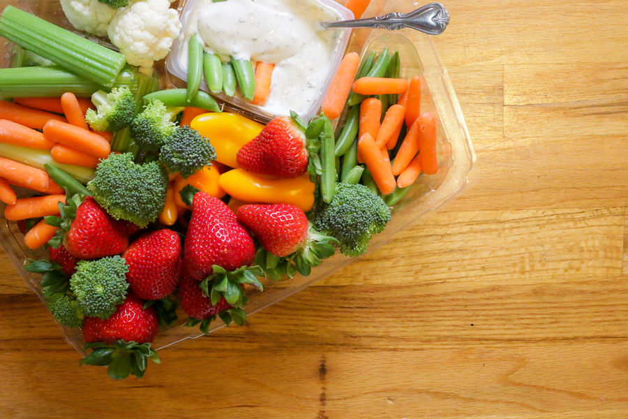 Fresh mix vegetables and fruits with dip on wooden background. Brocolli Carrot Cauliflower Celery Close-up Food And Drink Fruits Green Hand Healthy Eating Pepper Ranch Dressing Spoon Strawberry Vegetables