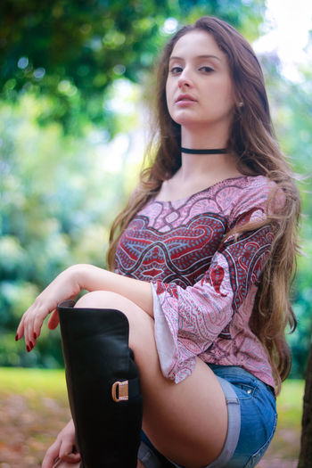 Abdomen Beautiful Woman Beauty Casual Clothing Day Fashion Fashion Model Focus On Foreground Leisure Activity Lifestyles Mid Adult Women Nature One Person Outdoors People Portrait Real People Standing Three Quarter Length Tree Women Young Adult Young Women