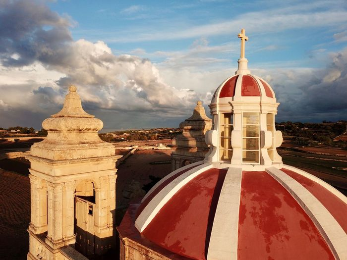 A drone shot of a Roman Catholic Church in Malta Drone  Drone Photography EyeEm Best Shots Marsaxlokk Church Dome Christian Christianity Gozo Church Buildings Cross Church Architecture Cathedral Malta Roman Catholic Church Church Roman Catholic Sky Built Structure Architecture Cloud - Sky Building Exterior Nature Religion Belief Spirituality Place Of Worship Travel Destinations Travel History Dome