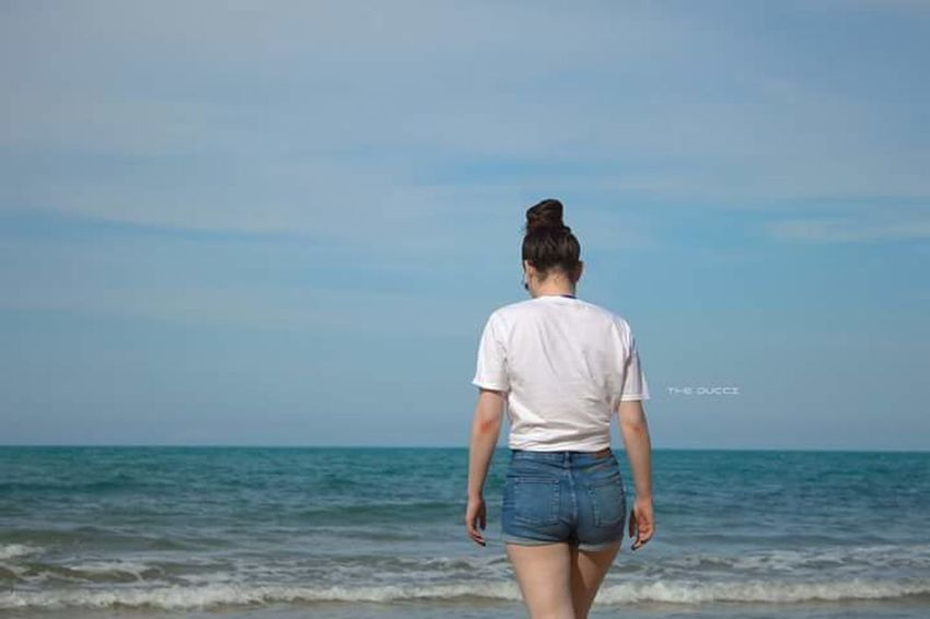 Leaving The Portraitist - 2018 EyeEm Awards Sea Beach Standing Blue Rear View Relaxation Back Shorts Sky Human Back Tranquil Scene Horizon Over Water