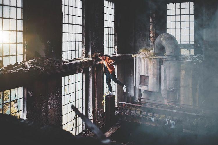 Man photographing through window