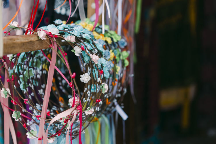 Close-up of multi colored decorations hanging at market stall