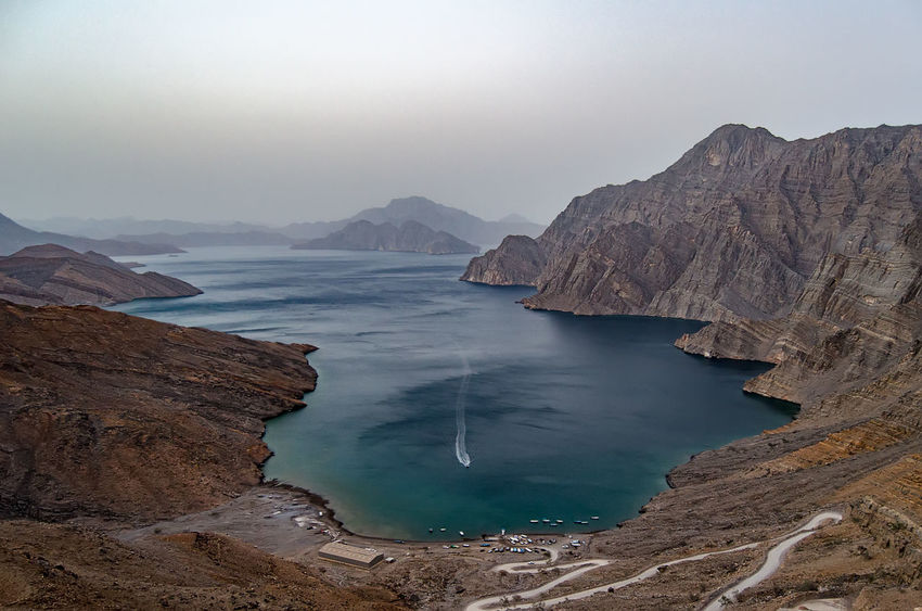 Beauty In Nature Clear Sky Cliff Day Khasab Khasab Fjord Landscape Mountain Mountain Range Musandam Nature No People Oman Outdoors Physical Geography Rock - Object Rock Formation Scenics Sea Sky Tranquil Scene Tranquility Travel Destinations Water
