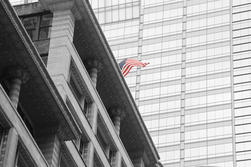 Colorsplash of the American flag in downtown Chicago Chicago Chicago Architecture Low Angle View Architecture Built Structure Building Exterior No People Day Flag Patriotism Building Outdoors Sky Window City Glass - Material Office Building Exterior Glass Cityscape City Blackandwhite Black & White Black And White Architecture Architectural Column