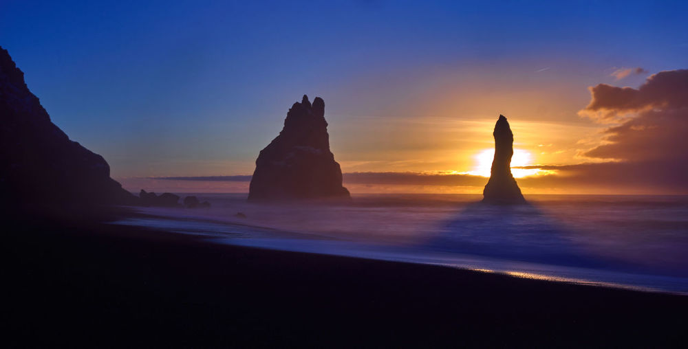 The trolls wake up Reynisfjara Church Iceland Rural Travel Winter Beauty In Nature Diamond Beach Horizon Over Water Iceland_collection Idyllic Landscape Nature No People Rocks Scenics - Nature Sea Seascape Silhouette Sky Sunset Tranquil Scene Tranquility Vik Water