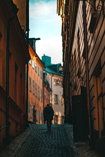 Walking One Person Architecture Building Exterior City Rear View Sky The Way Forward Alley Men Stockholm Old Town Tealandorange Built Structure Building Shadows & Lights Shadows