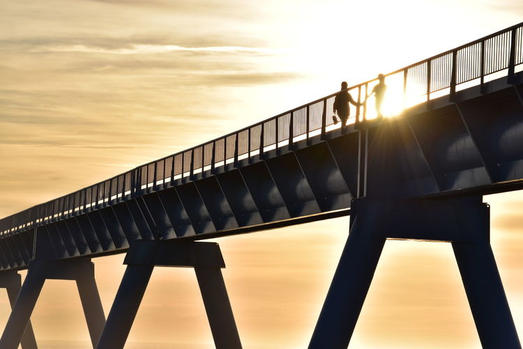 Love Architecture Bridge - Man Made Structure Built Structure Cloud - Sky Couple Of Lovers Day Low Angle View Nature Outdoors Real People Silhouette Sky Sun Sunlight Sunset Modern Love Second Acts
