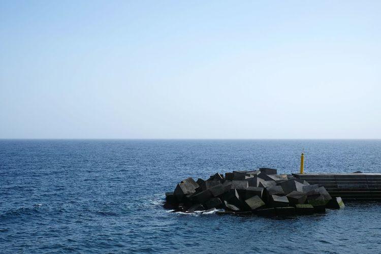 Groyne In Sea Against Clear Sky