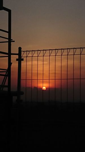 Sunset.. Prison Sunset Silhouette Security System Crime Barbed Wire Accidents And Disasters Protection Confined Space Safety Razor Wire Chainlink Fence Chainlink Wire Mesh Grid Crisscross Hexagon Link Cage Love Lock Padlock Security Bar Prisoner Boundary Prison Bars Prison Cell Wooden Post Fence Justice - Concept Dramatic Sky My Best Photo