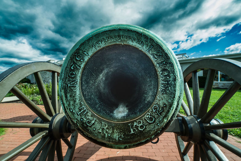 As I stood here looking at this marvelous weapon, I cannot help but hear the sparks running as the fuse is lit, the boom! that follows, and the screams that endure as the lead ball rips it's way through limbs, and extremities of fellow countryman. I am not sure who's cannon this was, or whether it is a true piece of history or a replica, but it is terrifyingly beautiful and I am still in awe every time I look at this photo that I took. Battlefield Civil War Destruction Irix 15mm Nikon Union Antietam  Artillery Cannon Civil War History Close-up Cloud - Sky Confederacy Cufotos Day History Metal No People Outdoors Sky United States Of America Us History War Weapon Wide Angle