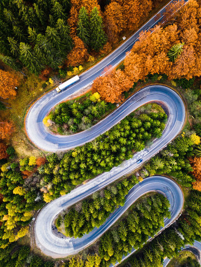 Winding road from high mountain pass, in autumn season, with orange forest. Aerial view by drone. Romania View View From Above Aerial View Road Mountain Winding Road Dronephotography Drone  Nature Forest Lanscape Photography Dji DJI Mavic Pro Trees Destination Landscape_photography Natural Roads Valley Autumn Autumn colors